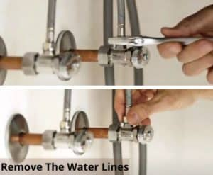 Remove the water lines before trying to remove the kitchen faucet